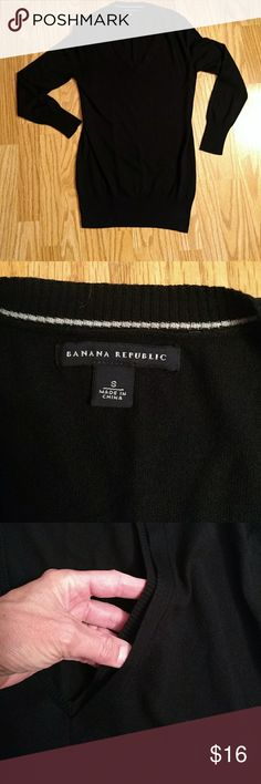 Banana Republic black silk & cotton blend sweater Banana Republic black v neck light weight sweater. 52% silk, 35% polyester, 13% cotton. Super soft  and comfortable. Looks great with leggings since it's a little long.    Has an interesting double layer neckline  (see photo #3) and is very light (see photo #4)   Hand wash cold and lay flat to dry. From a pet and smoke free home. Banana Republic Sweaters V-Necks