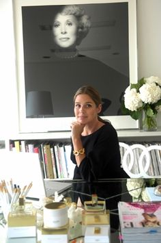 Aerin Lauder in her office w/ large photo of her grandmother Estee Lauder