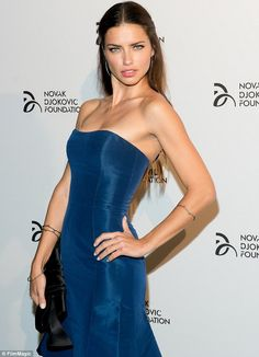 Into the blue: Adriana Lima looked absolutely bewitching in her incredible dress at the event