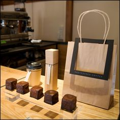 Omotesando Koffee This hidden gem is to become one of Tokyo's key community players amidst a recent wave of 'new generation' coffee shops. It's owner, Eiichi Kunitomo – operates the serving process from within a kiosk-inspired minimalist steel cube, located within a traditional Japanese house which forms the outlet and the basis of the shop's distinctive identity. Details »
