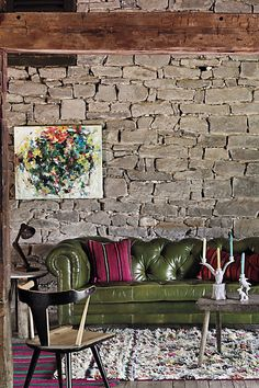love love love! rock wall & leather couch