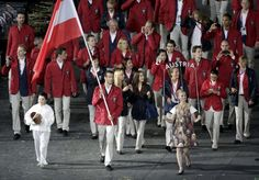 Austria's flag bearer Markus Rogan holds the national flag as he leads the contingent in the athletes parade during the opening ceremony of the London 2012 Olympic Games at the Olympic Stadium July 27, 2012.