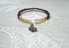 Flexible Wine red crochet bracelet with memory wire, golden swarovski crystals and wooden butterfly charm by MazeOfLace on Etsy