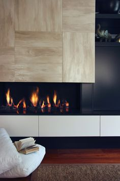This fire place is sitting proud of the wall which is a great feature. Love the stone tile.