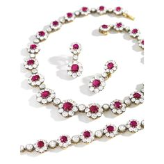 Ruby and Diamond Demi-Parure Comprising: a necklace designed as a series of floral links, surrounded and spaced by old mine-cut diamonds; a bracelet and pair of earrings en suite; the rubies and diamonds altogether weighing approximately 29.95 and 48.25 carats respectively, mounted in silver top gold, length of necklace and bracelet approximately 375mm and 165mm respectively.