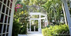 Become man and wife beneath this open-air gazebo surrounded by a lush garden at Sandals Royal Bahamian in Nassau, Bahamas. | Sandals Resorts Weddings