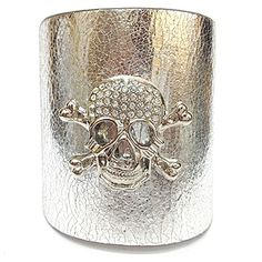 "This leather cuff is constructed of thick, resistant, genuine leather, has a snap closure feature, and is accented in a crystal-studded skull matching the leather color. The cuff is adjustable for a desirable fit. Material: Genuine Leather - Size: 10"" Long x 3"" Wide - Color: Silver $39.99"