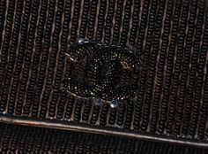 CHANEL, by Karl LAGERFELD, circa 1985. A small black calfskin leather shoulder bag completely covered with black sequins, the raised double C initials embroidered with small black beads. OMG!