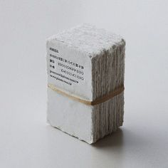 more branding than packaging but love the natural look, letterpress but really it's about that rubber band!
