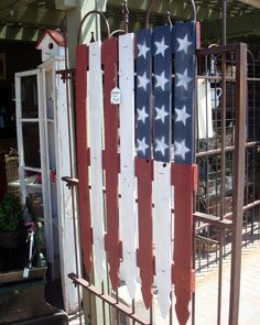 American flag made from a piece of picket fence (from Starshine Chic)