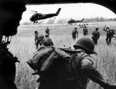 """""""In the Bush"""" -- Larry Burrows—Time & Life Pictures/Getty ImagesThe view from inside Marine helicopter Yankee Papa Vietnam, March 1965 Vietnam History, Vietnam War Photos, Laos, Indochine, North Vietnam, Us Marines, American War, Vietnam Veterans, Photo Essay"""