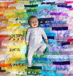 So many tiny fabric scraps all sewn together to create beauty! ❤️ Oh and of course one beautiful babe. 💜 . . #newborn #mimsdandydolls #rainbowquilt #handmade #patchworkquilt #vintagefabric