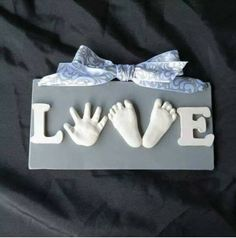 DIY hand and foot print 'love' sign