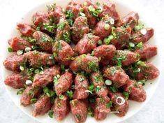 Chi Kofte (Armenian Steak Tartare) also has a Lebanese cousin called Kibbeh Nayyeh. They are nearly identical, featuring raw meat and bulgur wheat, but are shaped and served differently. With this recipe you can easily make both variations! Armenian Recipes, Lebanese Recipes, Armenian Food, Irish Recipes, Kufta Recipe, Yogurt Drink Recipe, Comida Armenia, Steak Tartare, Kebab Recipes