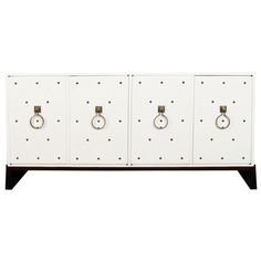 Studded Sideboard by Tommi Parzinger | From a unique collection of antique and modern sideboards at http://www.1stdibs.com/furniture/storage-case-pieces/sideboards/