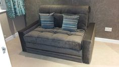 York sofa bed including fully upholstered arm rets and handy storage drawer.