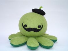 Stuffed Salvador Dali octopus toy in green fleece with tiny beret. $25.00, via Etsy. Octopus Plush, Salvador Dali, Yoshi, Berets, Toys, Handmade Gifts, Pop Culture, Green, Babe