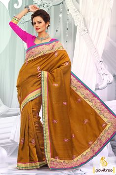 Embellished with lace patti, resham and embroidery works. The baghalpuri, brocade and dhupion made golden pink designer party wear Saree is attractive.