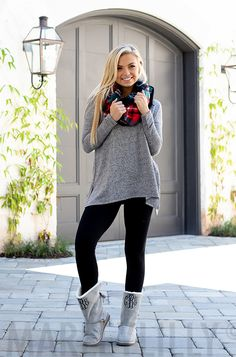 Your new favorite comfy, long sleeve tunic is HERE! This super soft personalized tunic features a v-neckline, a shark bite hem and a front pocket with your monogram!