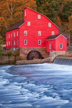 Red Mill - Clinton, New Jersey: There is nothing like a mill and stream to trigger nostalgia for yesteryear and it's even more so if the mill is painted red and the mill race is still intact. But the very best is if the mill is still active. Places To See, Places To Travel, Picture Store, Water Mill, Lake Water, Red Mill, Old Barns, New Jersey, Jersey Girl