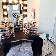 """This sanctuary of uber talented makeup artist and my #vanitygirloftheday @priscillaono. This was her IG post organizing her everyday makeup. I love the """"skinny"""" boxes by @sherrieblossom and the lipstick lamp adds a very whimsical touch. Mirror: #blackbroadway Table Top from VanityGirlHollywood.com $399"""