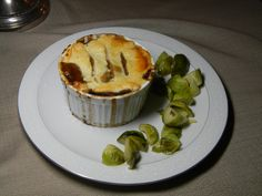 Based on Colonial Game Pie from The Williamsburg Cookbook 2 duck legs 1/2 tablespoon canola oil 1 ½ lb goat stew meat 2 lb venison 2 tablespoons canola oil 1 cup sherry 3 cups Sauce Diable (recipe …