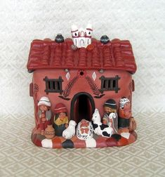 This Nativity from Peru shows the Holy Family and shepherds in front of a clay house. Each character is hand-shaped individually, then mount...