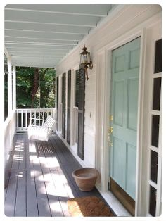 China White exterior, Kendall Charcoal shutters, Whythe Blue door (and lighter version on porch ceiling.  Benjamin Moore.