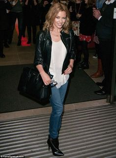 Kylie Minogue - leather jacket, jeans and booties