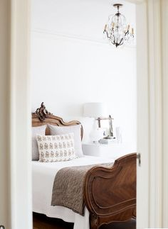 keep things neutral with natural woods, textures, and white bedding