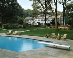 In ground pool surrounded by slate tiles ~ Allan Greenberg Architect