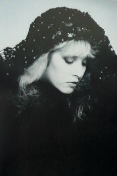 a beautiful black and white photo of Stevie, her pale hair contrasting sharply with her hooded shawl and makeup, especially her eyes ☆♥❤♥☆