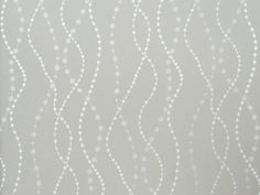 Raindrops Wallpaper Pale grey wallpaper with wavy bead design in silver and pewter.