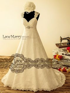 761b79c12b4 Stately Lace Wedding Dress in Wide A Line with Queen Anne Neckline and  Keyhole Back Featuring Buttons Till Hem