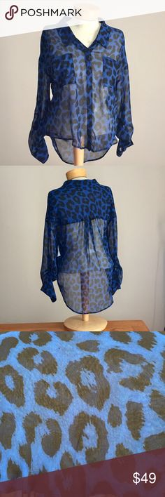 "Free people blue leopard sheer buttonfront. Xsmall Like new Free people blue leopard sheer buttonfront top. Size Xsmall. 20"" long in the front and 27"" long in the back. Polyester Free People Tops Blouses"