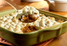 Gooey marshmallows top a cinnamon-seasoned sweet potato purée for a delicious side dish that pairs perfectly with ham or turkey.