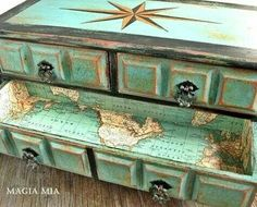 Cool sea green with a compass point and map lined drawers