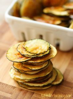 Zucchini Chips - slice very thin and press between sheets of paper towels to remove moisture. Line up on a baking sheet and brush with olive oil, sprinkle w salt. Bake at 225 for 2+ hours till they dry and crisp..