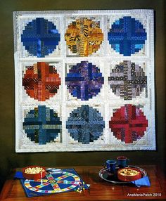 Curved Log Cabin  |  see http://www.heyquilty.com/content_downloads/BAGG_CLogCabin.pdf  for an example of assembling a 9-inch block