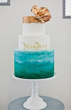 Watercolor wedding cake baked with love by Sweet and Saucy Shop. See more tasty treats here http://www.weddingchicks.com/2013/08/29/cake-toppers/