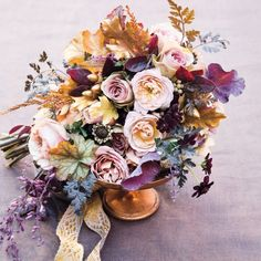 A clutch of blooms in our choice palette: lavender- chocolate. Notice how intermediary shades, like peach, ultraviolet, and copper, lend movement to the palette. The composition moves beautifully from the deep, rich shades to the soft, feminine ones. A gem of a piece, with movement and intrigue, that can be easily scaled to size.