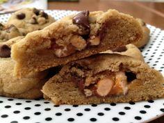 http://sallysbakingaddiction.com/2012/02/26/snickers-bar-stuffed-chocolate-chip-cookies/
