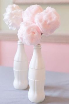 Fairy floss centrepieces .... flowers in sprayed coca cola bottle?