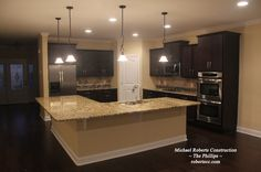 L shaped kitchen island is perfect for an open floor plan.  ~The Phillips~ :http://robertscc.com/the-phillips/nggallery/page/1  #michaelrobertsconstruction #custombuilder #coastalgeorgia #kitchens