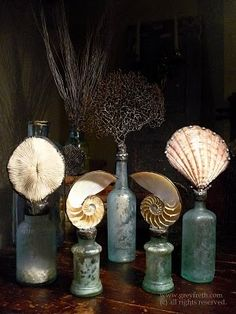 Antique bottles become Shell and Sea Life Sculptures. Greyfreth - Gifts From the Sea ~ I'm pretty sure I can DIY these Seashell Art, Seashell Crafts, Beach Crafts, Seashell Projects, Altered Bottles, Antique Bottles, Bottles And Jars, Vintage Bottles, Objets Antiques