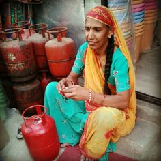 Familiarity  A rajasthani female in her traditional colorful rajasthani odhni and saree