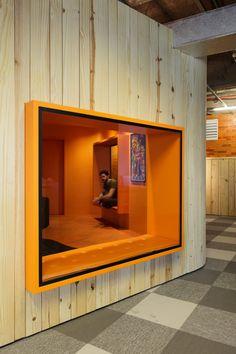 Enclosed meeting room; open office floor plan