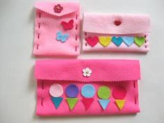 These adorable and colorful felt pouches are a great felt craft for kids.: A Great Felt Craft for Kids - How to Make Cute and Colorful PouchesGather your materials to make these pretty felt pouches.Cut felt into a rectangle to begin making the pouch.Take a ruler and pencil and mark where the holes will go to sew the felt pouch.Use a craft knife to poke holes where the marks are.Now your child can thread the needle through the holes.Sew one side of the felt pouch and tie off the end.Sew the…