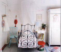 where do I begin... Mushrooms, bunnies, iron crib, white, red, light blue... I think this is my dream nursery