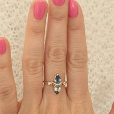 One of a kind ring with pear cut bicolor sapphires, peach sapphires and old European cut diamonds set in 14k yellow gold. Available in the store for $4700. One of my favorites I've made in a while